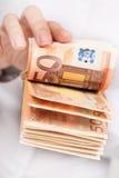 Money in hand. Stock Photos