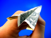 Money in hand 2. A hand holds a paper airplane made of money royalty free stock photography