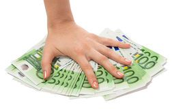 A money is in hand. A money is in womanish hand Stock Photography