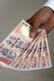 Money in hand. Close up of a  hand with indian currency holding tousand rupee notes Stock Photography