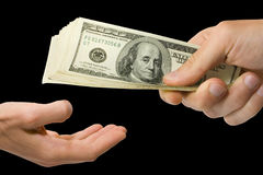 Money in hand. Isolated on the black Stock Images