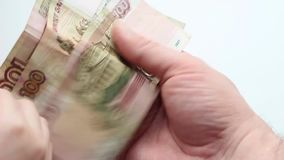 Money in hand. The child`s hands to shift money into the hands of men stock footage