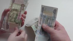 Money in hand. The child`s hands to shift money into the hands of men stock video