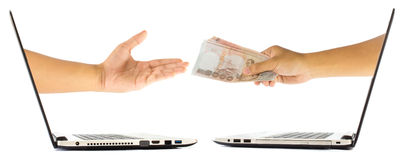 Money in hand grom laptop Stock Photos
