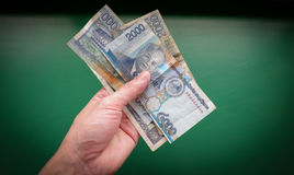 Money in hand. Have money lucrative stock photography