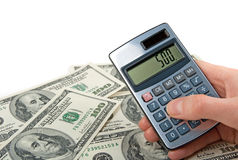 Money and hand holing a calculator. American dollars and female hand holding a calculator, on white background Royalty Free Stock Image