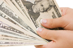 Money in hand, isolated Royalty Free Stock Photos