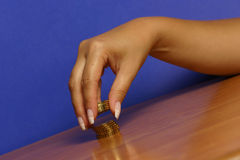Money and hand. A hand picking up (or stacking up) some coins Royalty Free Stock Images