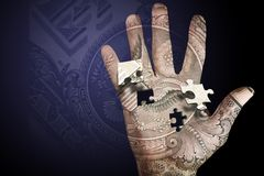 Money Hand Puzzle. Hand with seal and puzzle pieces stock photo