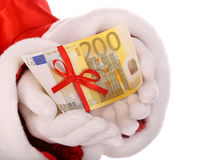Money in hand of santa claus. Isolated Royalty Free Stock Photo