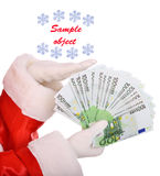 Money in hand of santa claus. Isolated Stock Images
