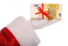 Money in hand of santa claus. Isolated Stock Photo