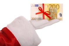 Money in hand of santa claus. Stock Photo