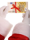 Money in hand of santa claus. Isolated Stock Image