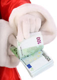 Money in hand of santa claus. Isolated Stock Photography