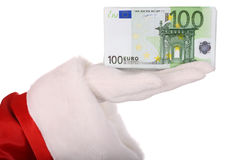 Money in hand of santa claus. Royalty Free Stock Image