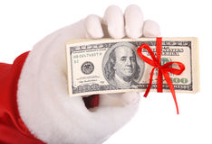 Money in hand of santa claus. Stock Photo