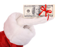 Money in hand of santa claus. Royalty Free Stock Photo