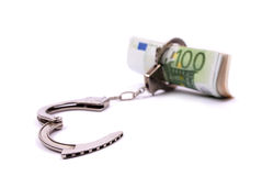 Money and handcuffs. Isolated on a white background Royalty Free Stock Photography