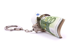 Money and handcuffs. Isolated on a white background Royalty Free Stock Image