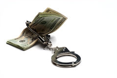 Money and Handcuffs. Isolated on white background Royalty Free Stock Images