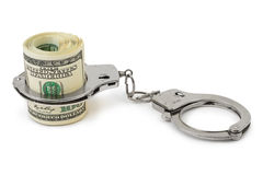 Money and handcuffs. Isolated on white background Stock Photos