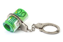 Money and handcuffs. Isolated on white background Royalty Free Stock Image