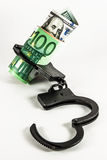 Money in handcuffs Stock Photography
