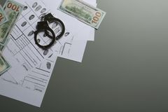 Money, handcuffs and fingerprint record sheets on grey background, top view with space for text. Criminal investigation royalty free stock image
