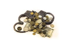 Money and handcuffs. Isolaned on white background Royalty Free Stock Photos