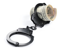 Money and handcuffs isolated. On white background Stock Photo