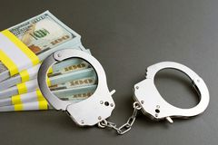 Money and handcuffs stock images