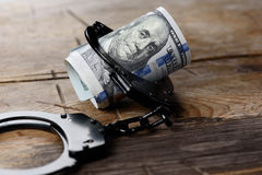 Money in handcuffs. Security concept. Money in handcuffs. Us dollar currency. Security concept Royalty Free Stock Image