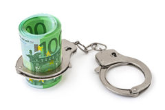 Money and handcuffs. On white background Royalty Free Stock Image