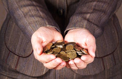 Money in the hands. Coins in the hands. Women gives money royalty free stock photography