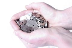 Money in hands. Hands holding coins (Norwegian) isolated on white background Stock Photography