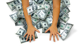 Money hands. Female arms grab a lot of money on a white background.  Concept for winnings or keeping money Stock Photo