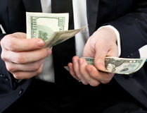 Money in hands Stock Photo