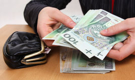Money in hands. Someones is holding money in hands Royalty Free Stock Images
