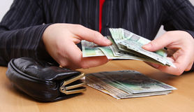 Money in hands. Someones is holding money in hands Royalty Free Stock Photography