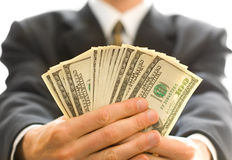 Money in hands. American dollars money in businessman hands Stock Photo