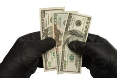 Money in hands. Dollars in black gloves royalty free stock photography