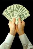 Money in hands Stock Image