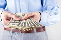 Money in the hands of the businessman Royalty Free Stock Images