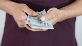 Money in the hands of men. Man holds, swap, in the hands of pack of dollars. Money in the hands of men stock video footage
