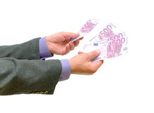Money in the hands of men on a white background. Hand with euro money on white background royalty free stock photography