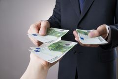 Money in the hands of the people. To count euro on gray background royalty free stock images