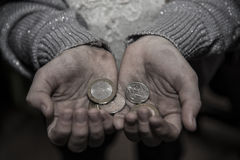 Money in the hands of the poor. Money in the hands of a poor woman who asks for alms Stock Photography