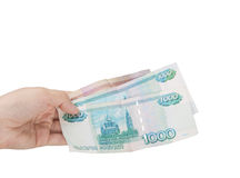 Money in the hands of. Russian banknotes in a female hand on a white background Stock Photos