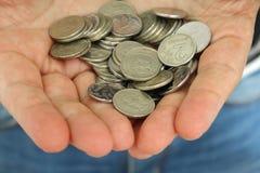 Money in hands. Russian metal money in the hands of men Stock Images